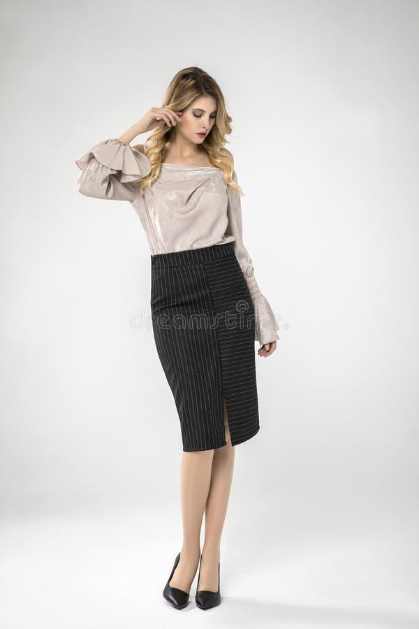 Free Sexy Blonde Model Posing In Black Skirt. Stock Photos - 183205203