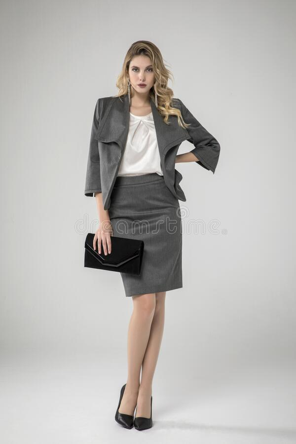 Free Sexy Blonde Model Posing In Shiny Chic Gray Suit. Royalty Free Stock Photography - 183180807