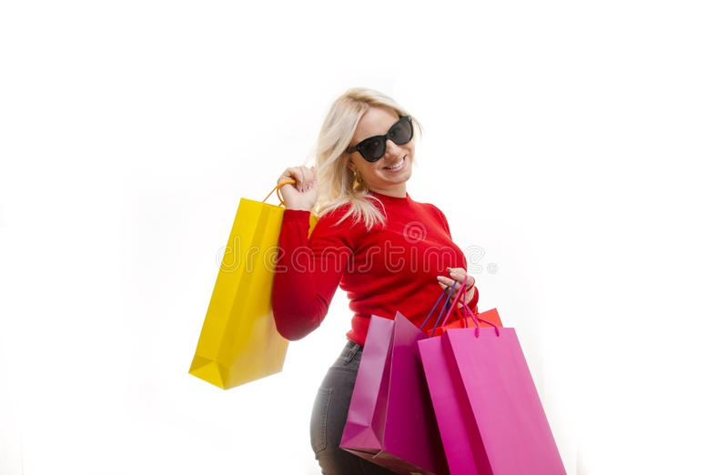 blonde posing in studio with shopping bags royalty free stock photography
