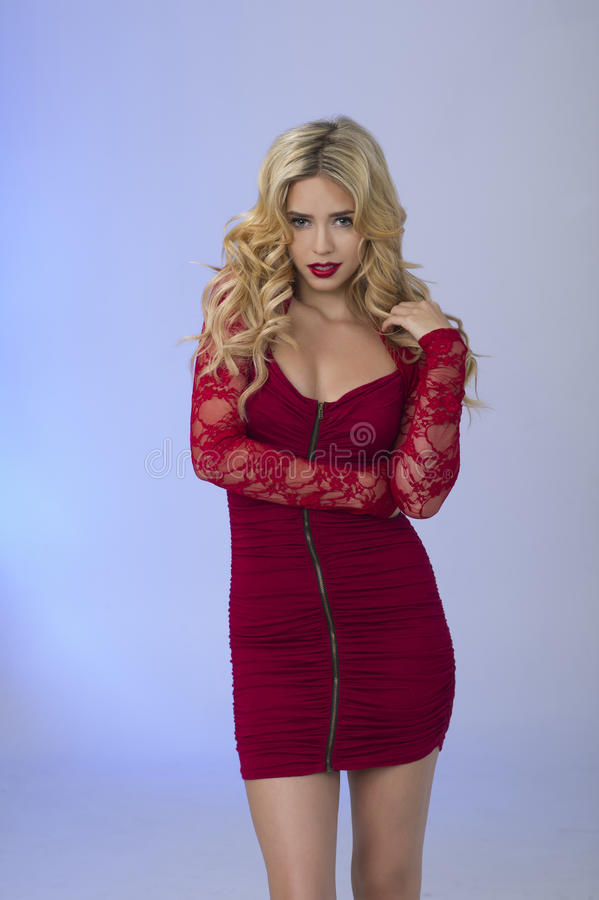 Blonde In Red stock photos