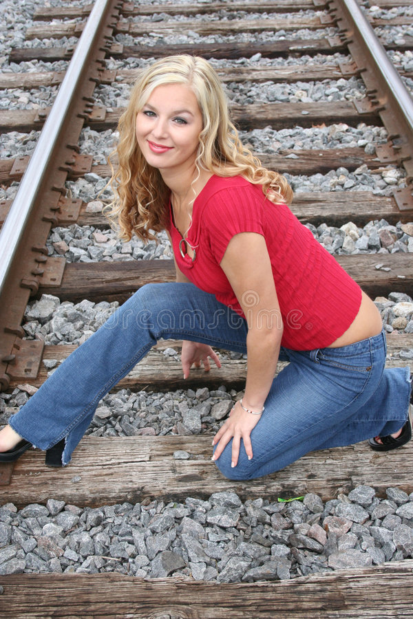 blonde on the tracks royalty free stock images