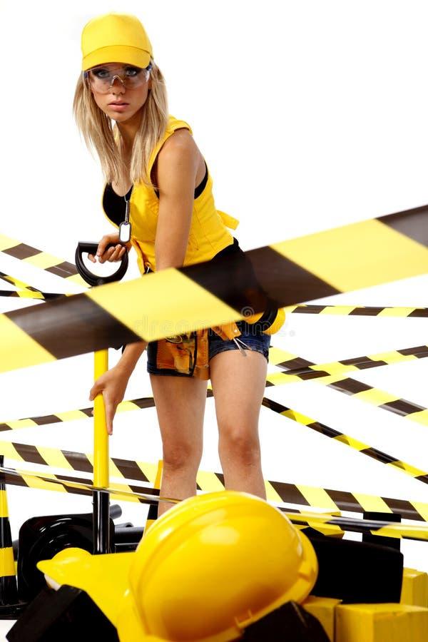 Sexy blonde vrouwelijke bouwvakker stock foto