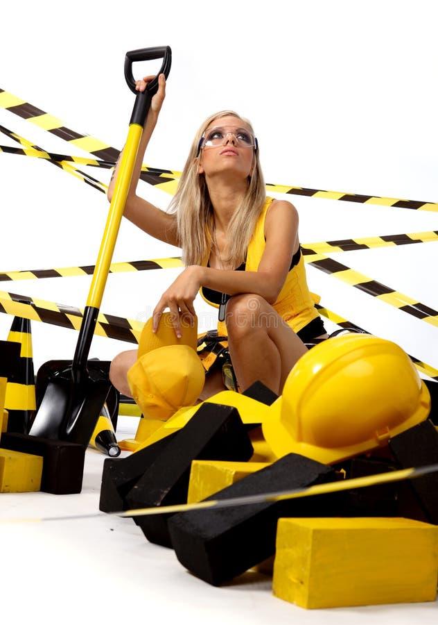 Sexy blonde vrouwelijke bouwvakker stock afbeeldingen