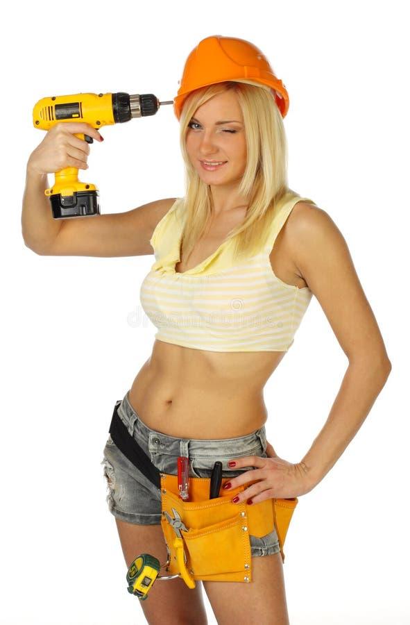 Sexy blonde vrouwelijke bouwvakker stock afbeelding
