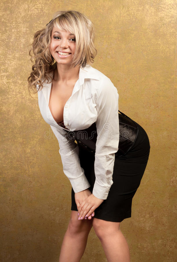 blonde woman in corset and skirt stock photos