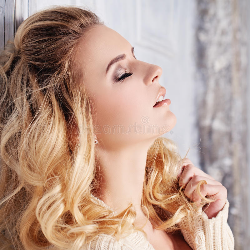 Blonde Woman. Face closeup royalty free stock image
