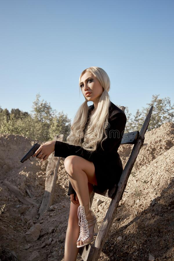 Woman Holding Gun Royalty Free Stock Images - Image: 9983819
