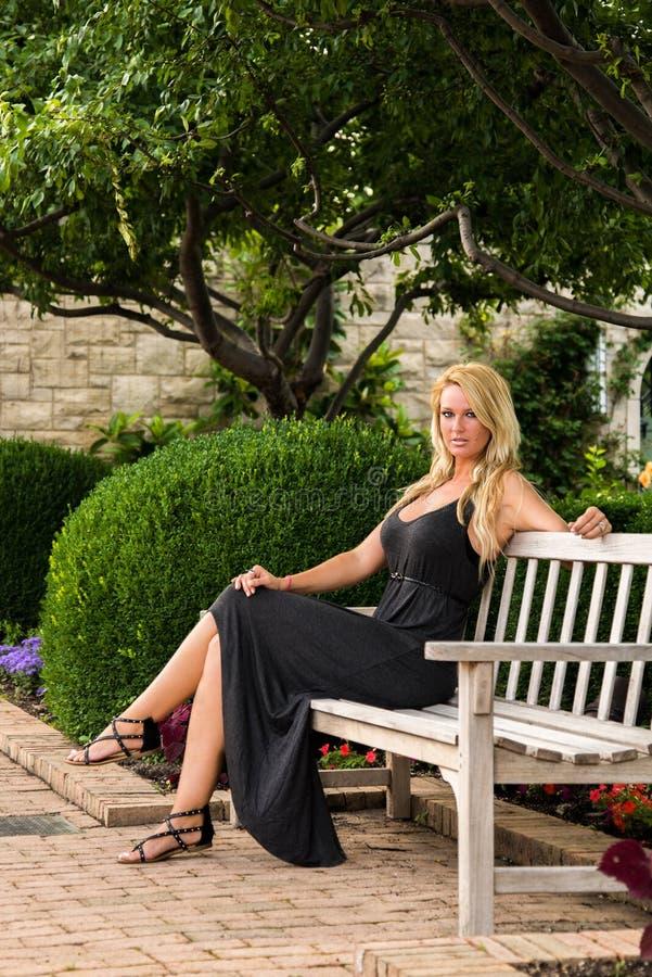 Blonde Woman Sitting On Bench Fashion Stock Photo Image