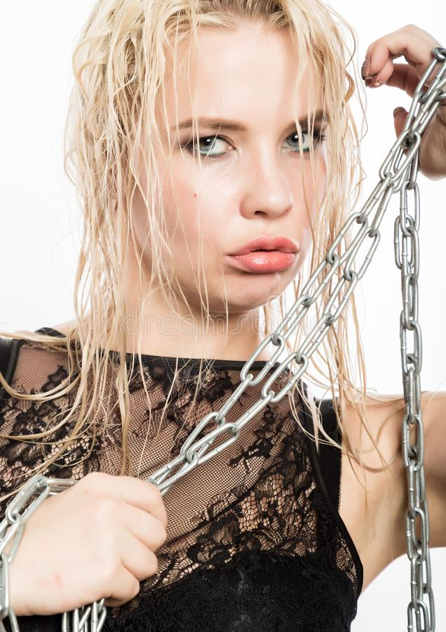 Sexy blonde woman with wet hair and plump lips holding a steel chain stock images