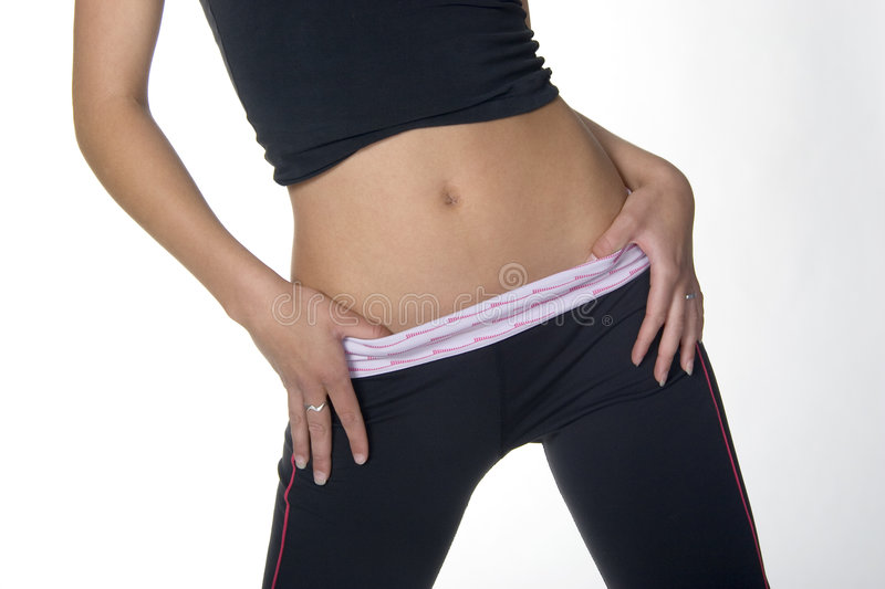 Body. Young woman's abdominal area wearing exercise clothes stock photography