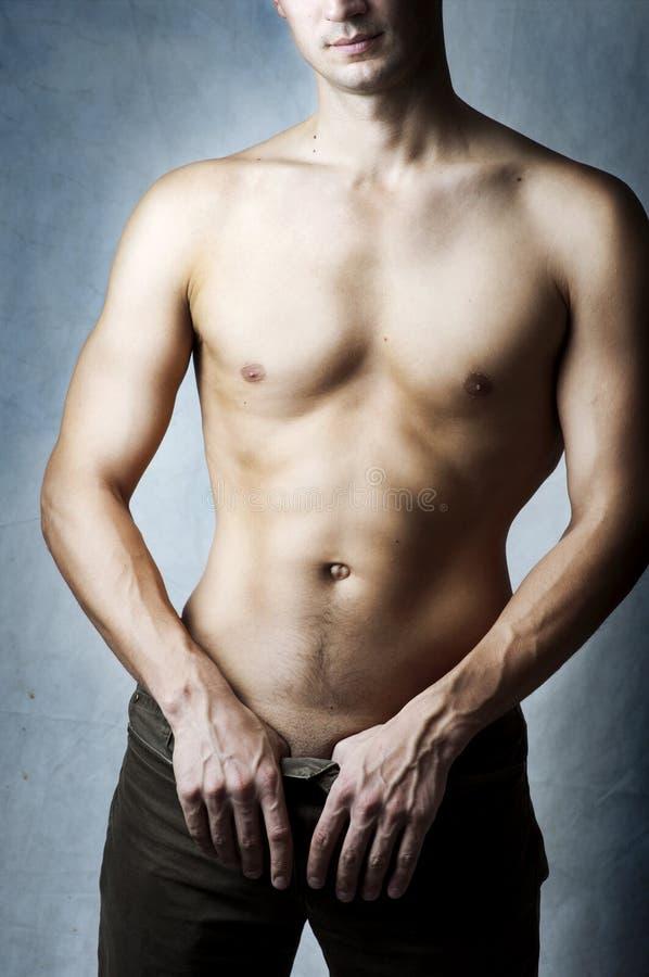 Body of muscular young man stock photos