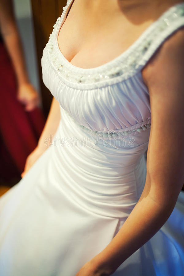 Bride cleavage. Bride dress showing cleavage royalty free stock photography