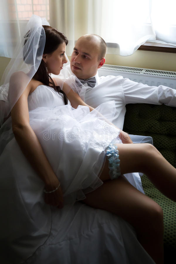 Download Bride With Groom On The Sofa Stock Photo - Image: 26411816