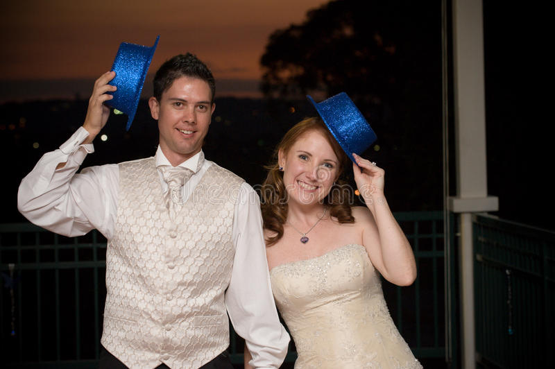 Download Bride And Young Handsome Groom With Blue Hats Stock Image - Image: 16857245