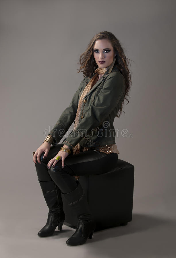 brunette girl with green denim military jacket and dramatic makeup stock image