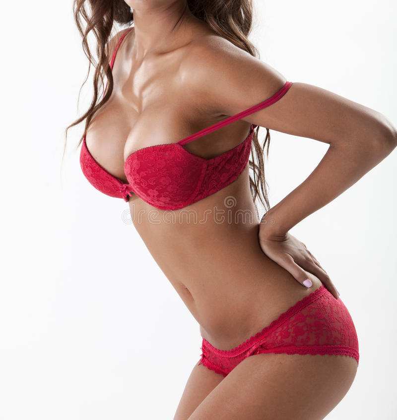 Sexy brunette with large breasts in red lingerie