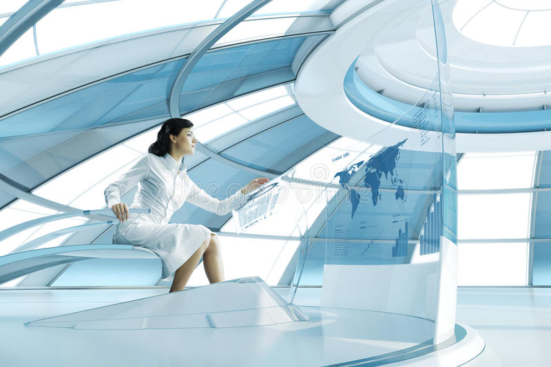brunette operating transparent future touch i stock photo
