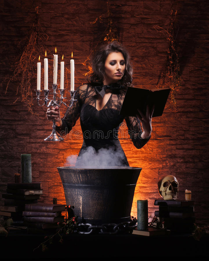 A brunette witch making poison stock photos