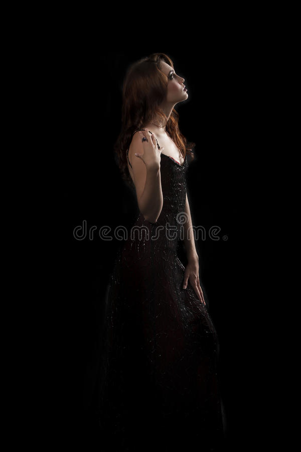 brunette woman with dark red sparkling evening dress stock photos
