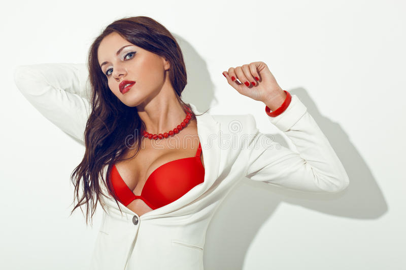 Download Brunette Woman Posing Over White Wall Stock Photography - Image: 25749072