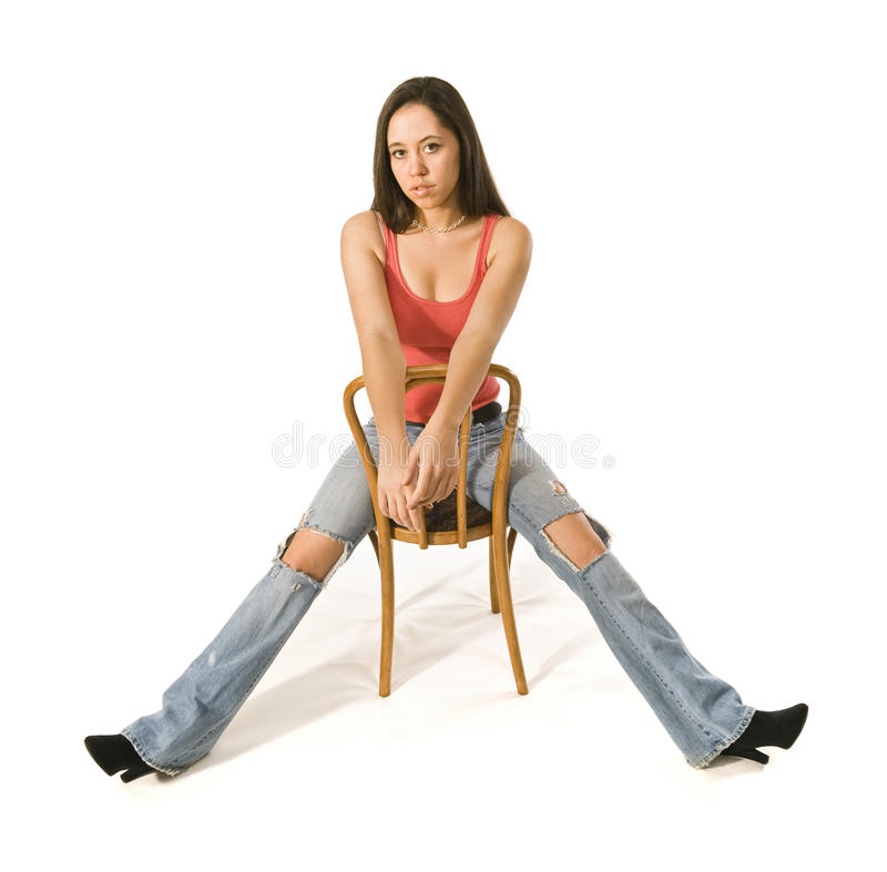 Download Brunette Woman Sitting, Torn Jeans Stock Image - Image: 12565731