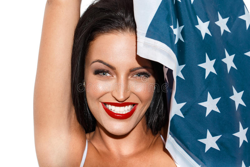 Brunette woman with usa flag. Star spangled banner, independence day, 4th july royalty free stock photography