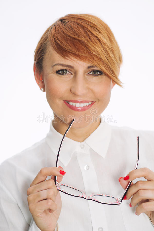 Business Woman with glasses. Smiling business Woman with glasses looking at the camera stock photography