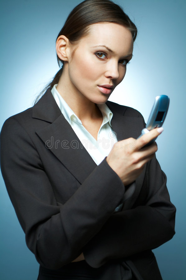 Business Woman MG. Beautiful and brunette business woman isolated on clear background is using mobile phone stock photo