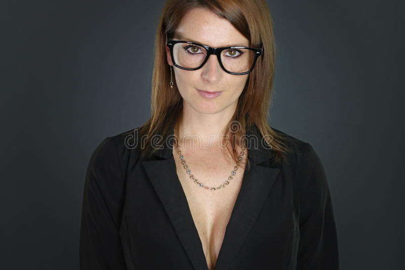 Businesswoman wearing eyeglasses. Over a gray background royalty free stock image