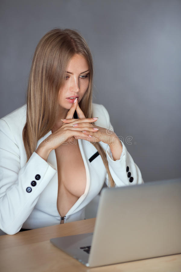 Businesswoman With Suit Over Nude Breasts Stock Photo