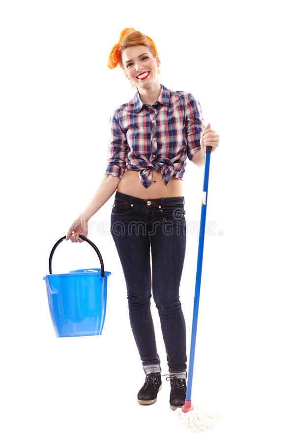 cheerful housewife with bucket and mop stock images