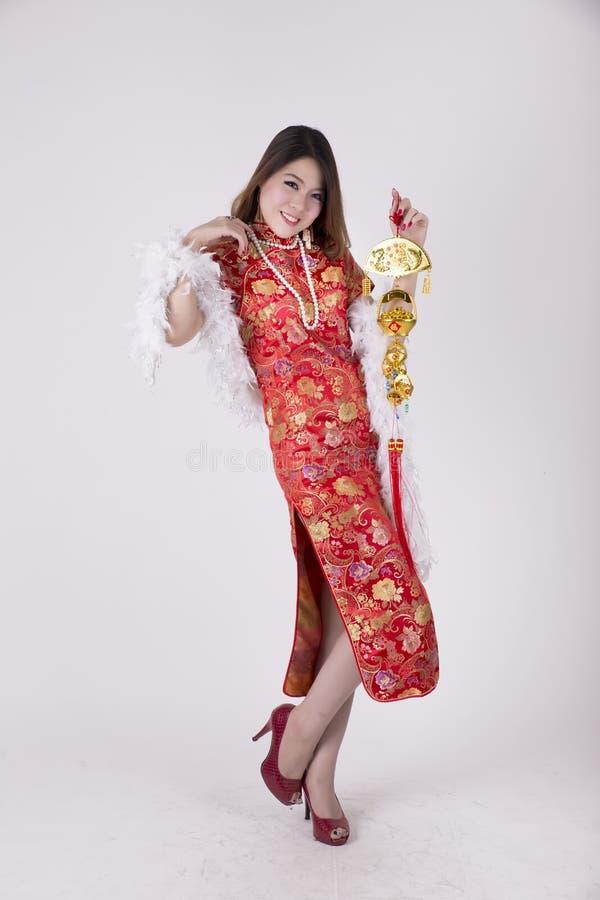 Cheongsam dress. Sexy Chinese woman dress traditional cheongsam at New Year, studio shot isolated on white background, adult, advertisement, asian, beautiful royalty free stock photography