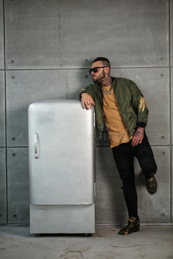 Fashion Portrait Of Naked Male Model With Tattoo And A Black Beard Standing In Hot -7307