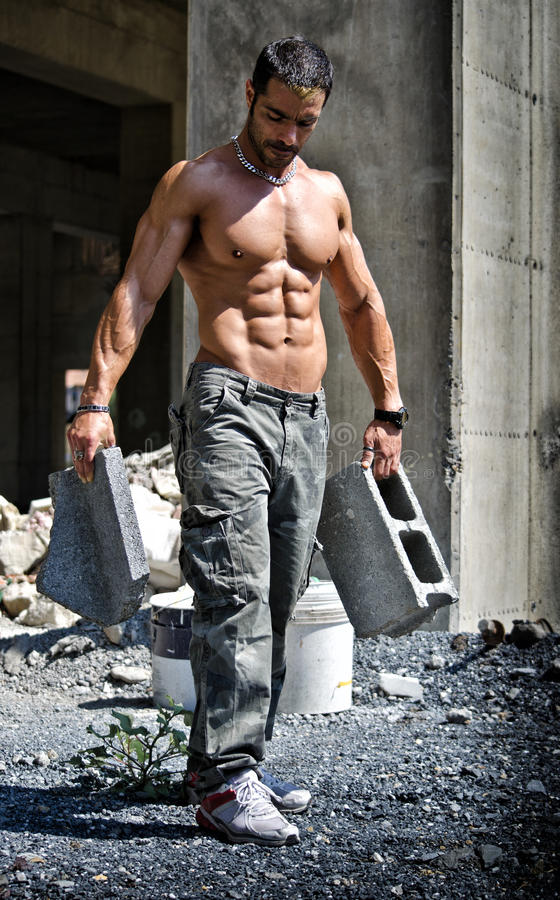 construction worker shirtless with muscular body stock photo