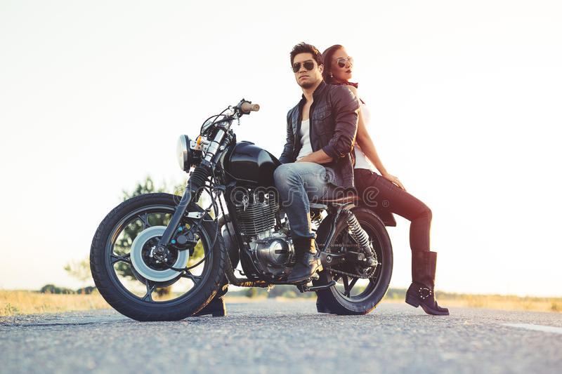 Couple of bikers on the vintage custom motorcycle. Picture royalty free stock images