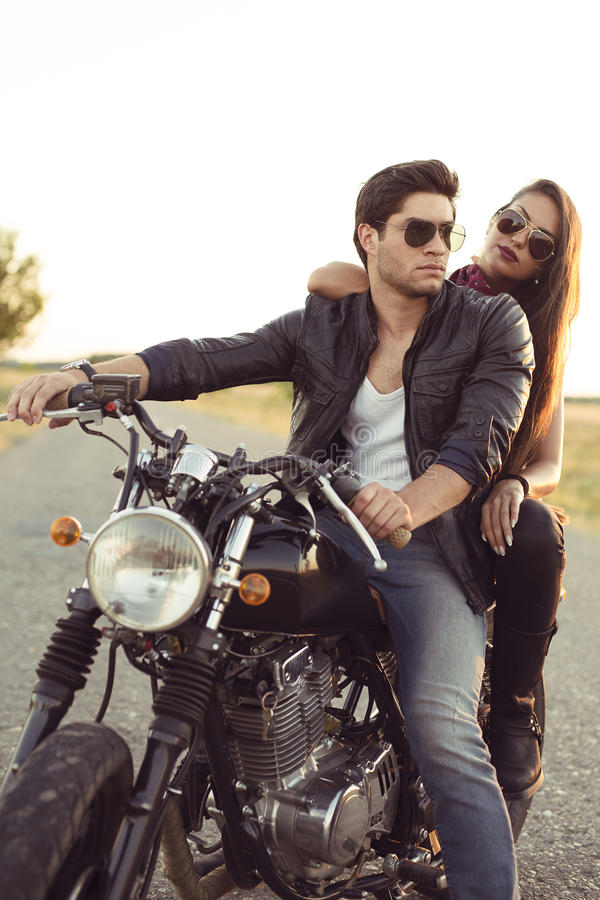 Couple of bikers on the vintage custom motorcycle. Picture royalty free stock photography