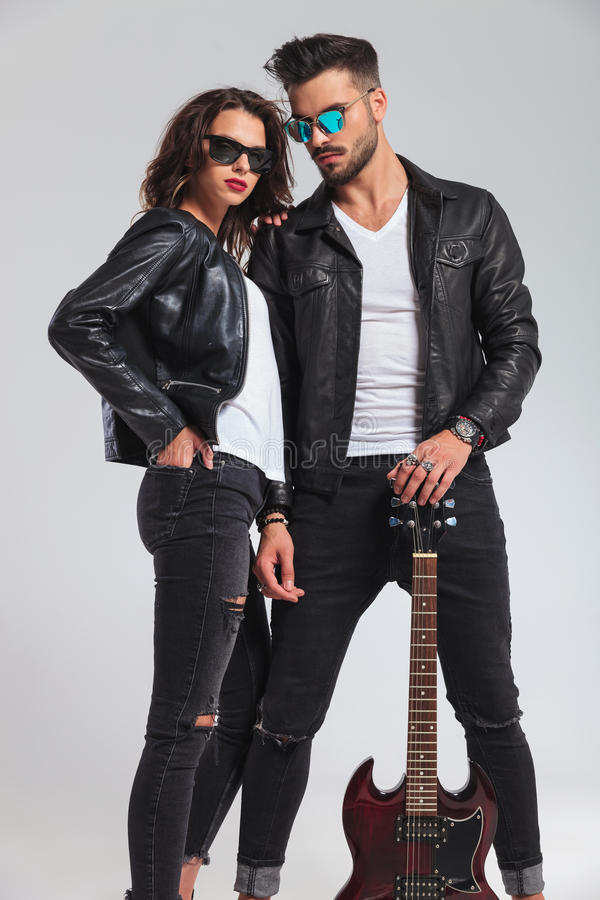 couple in leather jackets holding electric guitar royalty free stock photo