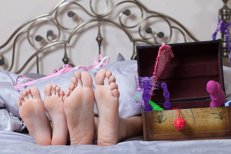 Sex toys on a bed