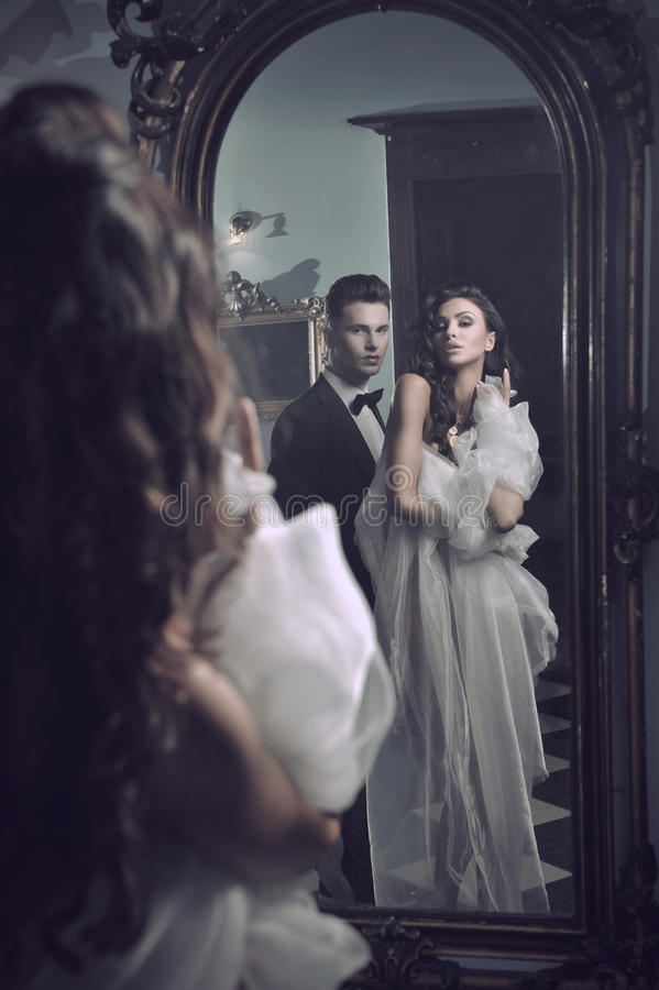 couple in the mirror royalty free stock photography
