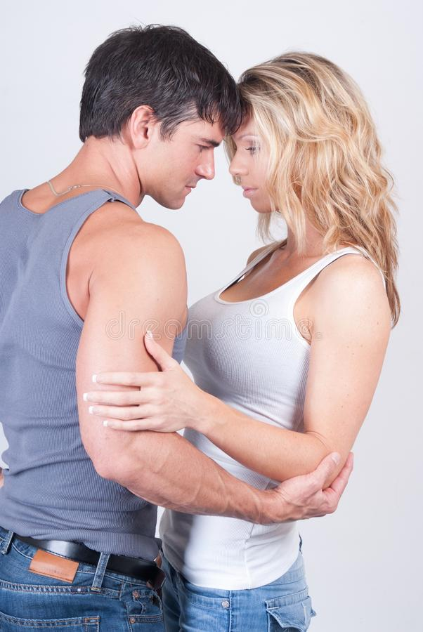 The couple poses for the camera. royalty free stock image