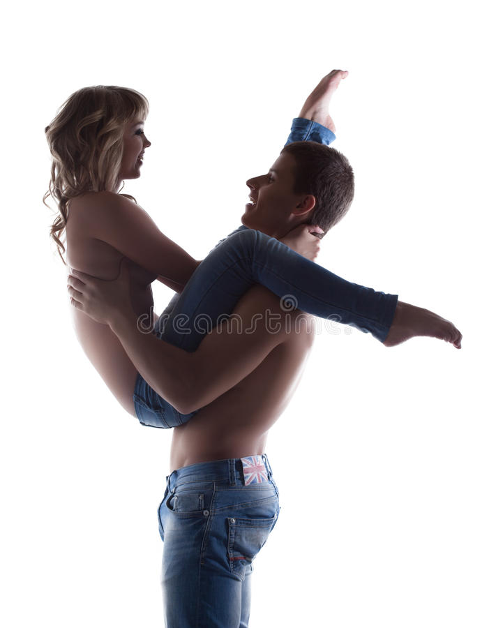 Couple Posing Topless In Jeans Silhouette Royalty Free Stock Images