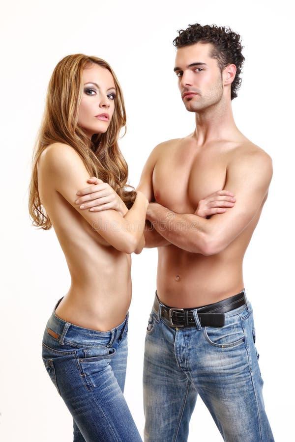 couple posing on white background stock images