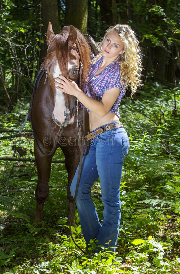 cowgirl with her stallion royalty free stock image