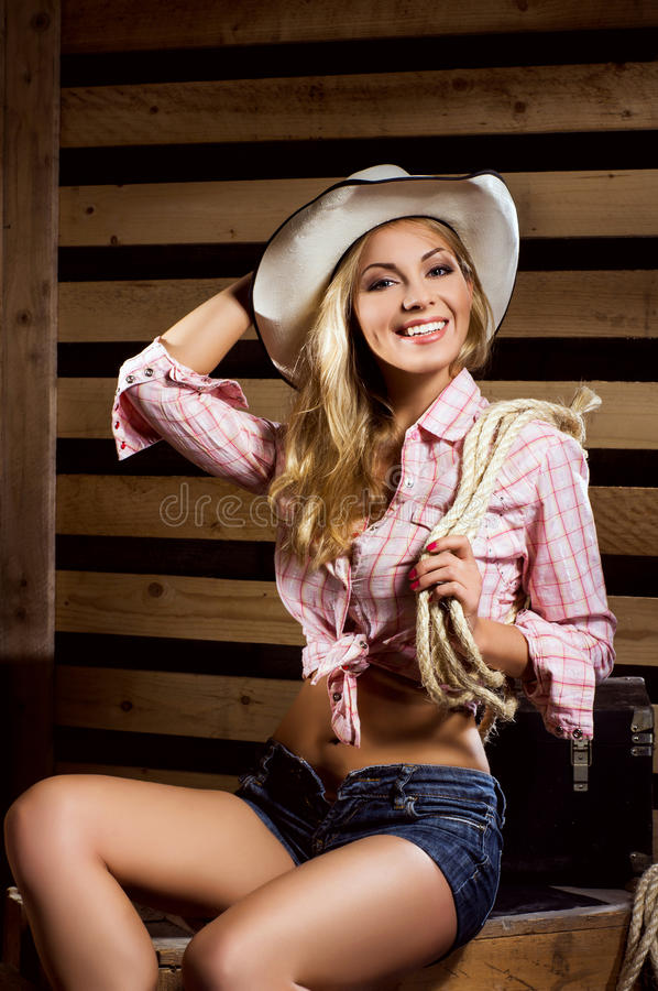 A cowgirl posing in a hat stock image