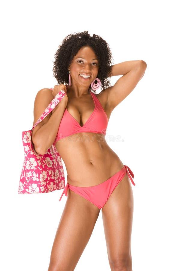Sexy curvy etnische gelooide vrouw in zwempak stock foto's