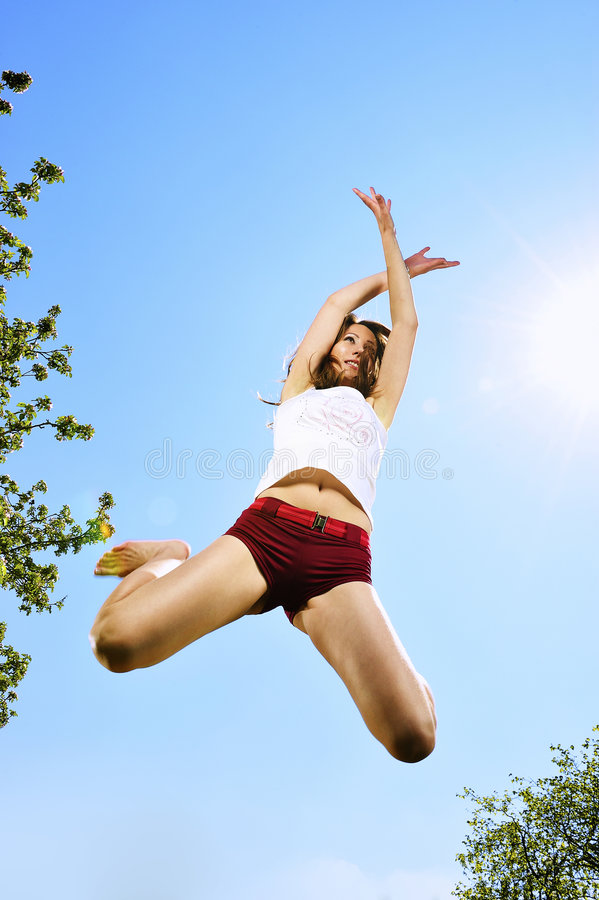 Dancer jumping. With blue sky royalty free stock photo