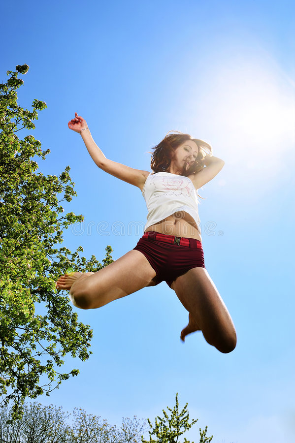 Dancer jumping. With blue sky stock photo