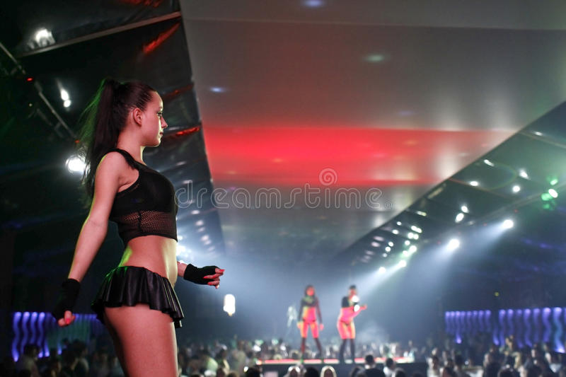 Dancers in a nightclub. Young female dancer is entertaining the audience at a party in a nightclub royalty free stock photo