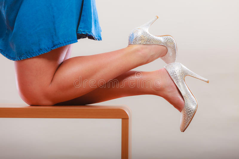 dancing woman legs in high heels and skirt. royalty free stock image