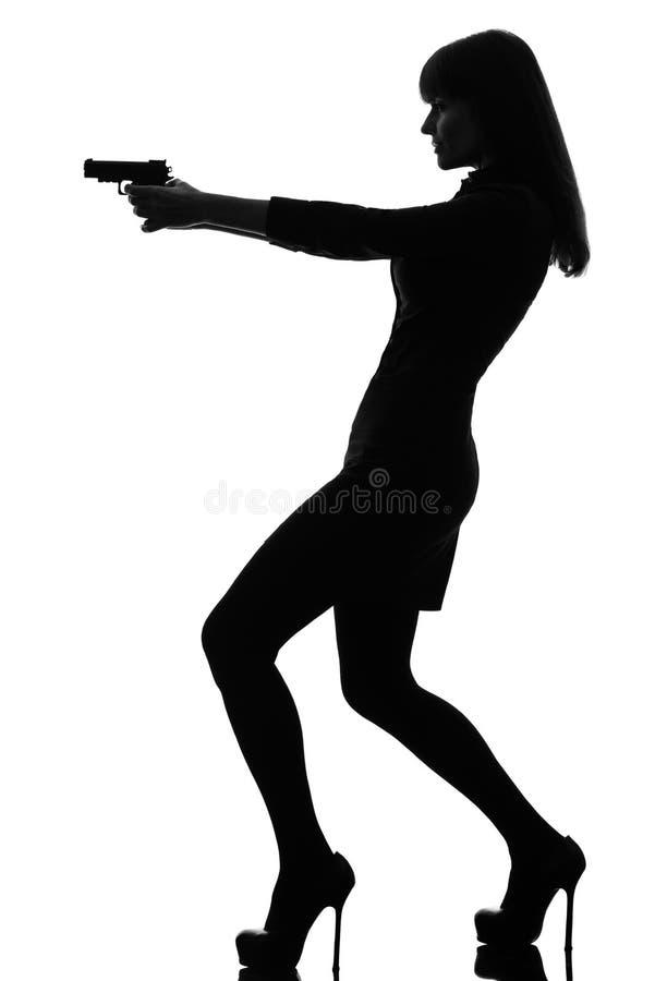detective woman holding aiming gun stock photo